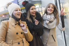 Three adult women in shopping stock image