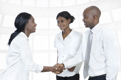 Three african business partners shake hands Stock Photography