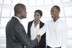 Three african business people handshake Stock Photography