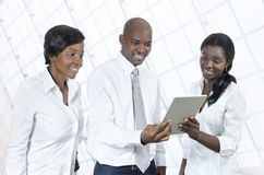 Three african business people with tablet PC Royalty Free Stock Image
