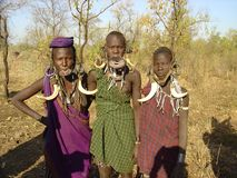 Three African grace of the Mursi stock photography
