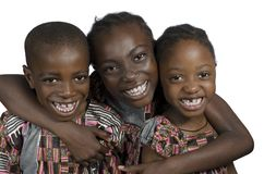 Three african kids holding on another smiling Royalty Free Stock Image