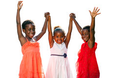 Three african kids joining hands in air. Stock Photos