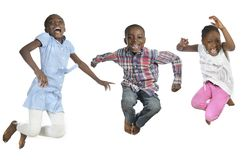 Three african kids jumping high Royalty Free Stock Image