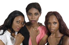 Three african women showing fists stock photos