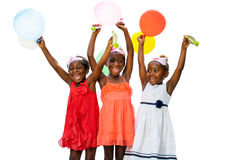Three african youngsters having fun with balloons at party. royalty free stock images