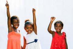 Three african youngsters raising hands. royalty free stock photo