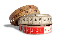 Three Ages Of Measuring Tapes Royalty Free Stock Images