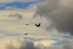 The three aircraft decided to fly around the cloud. The group single-engine aircraft flies the menacing cloud which is located on their way Stock Photos