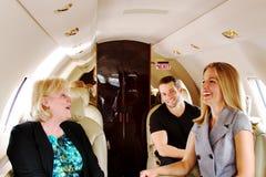 Three airline passengers enjoying a laugh Royalty Free Stock Photos