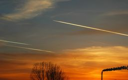 Three airplains flying in the sunset. stock photography