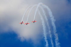 Three airplanes on air show. Three bright airplanes on air show Stock Photo