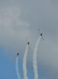 Three airplanes on air show with trails Stock Photos