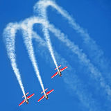 Three airplanes Extra EA-300 on airshow Stock Images
