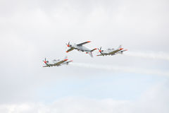Three airplanes performing aerobatic figure Royalty Free Stock Images