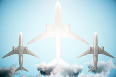 Three airplanes on sky background. Bottom view of three airplanes on bright blue sky background with sunlight. 3D Rendering Stock Images