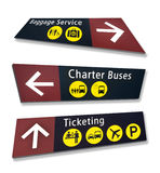 Three Airport Direction Signs at Crazy Angles Stock Images
