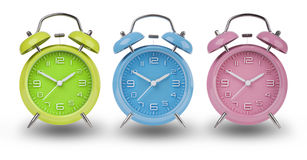 Three alarm clocks with the hands at 10 and 2 Stock Image