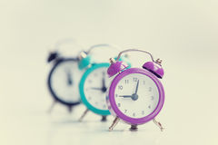 Three alarm clocks Stock Photo
