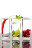 Three alcoholic beverages with fruits and berries Royalty Free Stock Photography