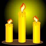 Three alight candles. Three burning candles on table stock illustration