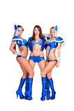 Three alluring dancers in blue club costumes Stock Images