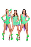 Three alluring go-go dancers Royalty Free Stock Photography