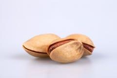 Three almonds  on white background Royalty Free Stock Photo