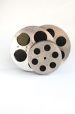 Three aluminum film reels. On a white background stock images
