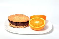 Three american biscuits and lemon Stock Images