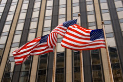 Three American Flags. In front of a building, in NYC Stock Image