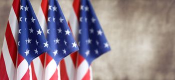 Three American flags. In front of blurred brown background royalty free stock images