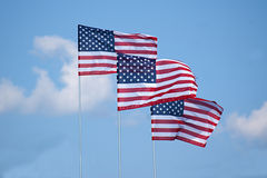 Three American Flags Waving in Clouds Royalty Free Stock Photo