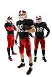 The three american football players posing with ball on white background Stock Photos