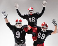 The three american football players posing on white background Stock Photo