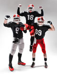 The three american football players posing on white background Royalty Free Stock Photography