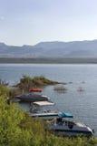 Three anchored boats. Three boats anchored along the shore of lake Roosevelt in Arizona stock photos