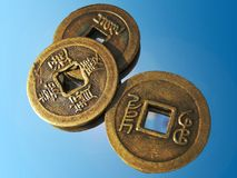 Three Ancient Chinese Coins on a mirror Royalty Free Stock Photography