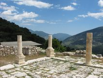 Three ancient columns and beautiful landscape as a background Royalty Free Stock Photography
