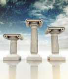 Three ancient columns at wintertime Stock Photos