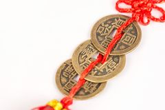 Three ancient Feng shui metal lucky coins isolated above white b royalty free stock photography