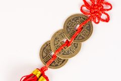 Three ancient Feng shui metal lucky coins isolated above white background Stock Photography