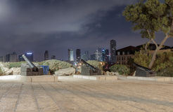 Three ancient guns, standing on pedestals on the observation platform  at night in old city Yafo, Israel. Three ancient guns, standing on pedestals on the Stock Image