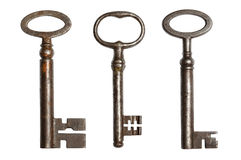 Three ancient keys. Isolated on white background royalty free stock photo