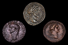 Three Ancient Roman Coins. Isolated Stock Images