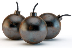 Three ancient round bombs Stock Photo