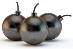 Three ancient round bombs Stock Photo