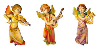 Three angels. Three ceramic musical angels holding different instruments vector illustration