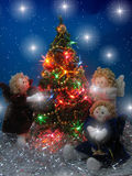 Three angels. And christmas tree Stock Image