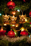 Three angels hanging on the Christmas tree Royalty Free Stock Photo